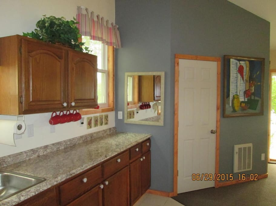 The kitchen offers counter space, a microwave, and full size refrigerator.