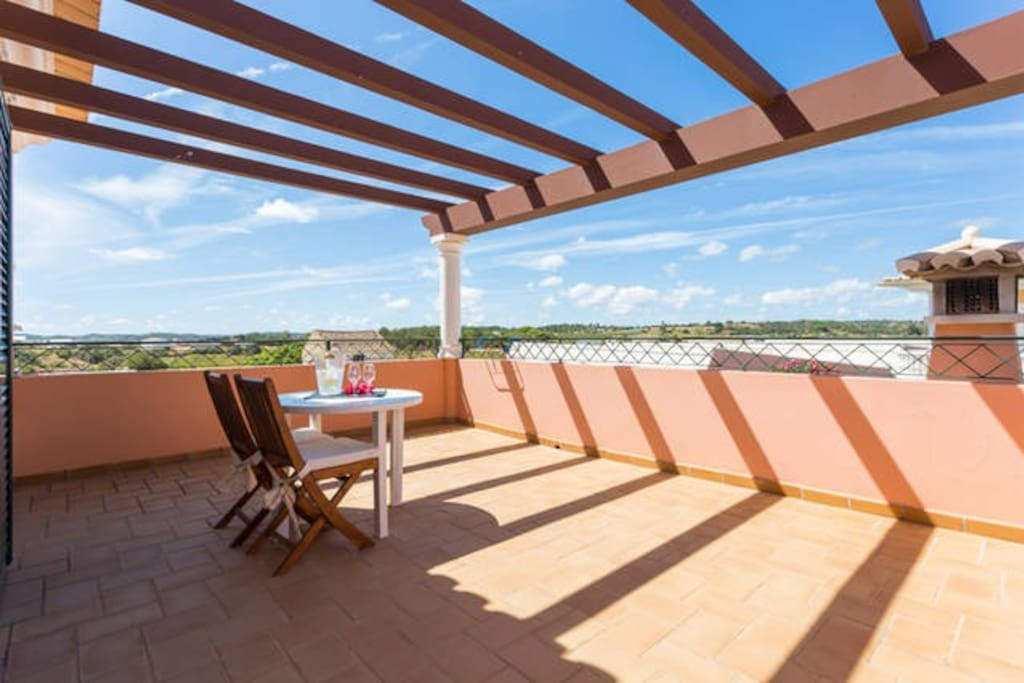 Spacious & Confortable Balcony to Enjoy a Great Glass of Wine under Blue Sky