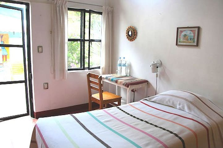 One of our clean and cozy single rooms with with closet, desk, wifi, and private bath.