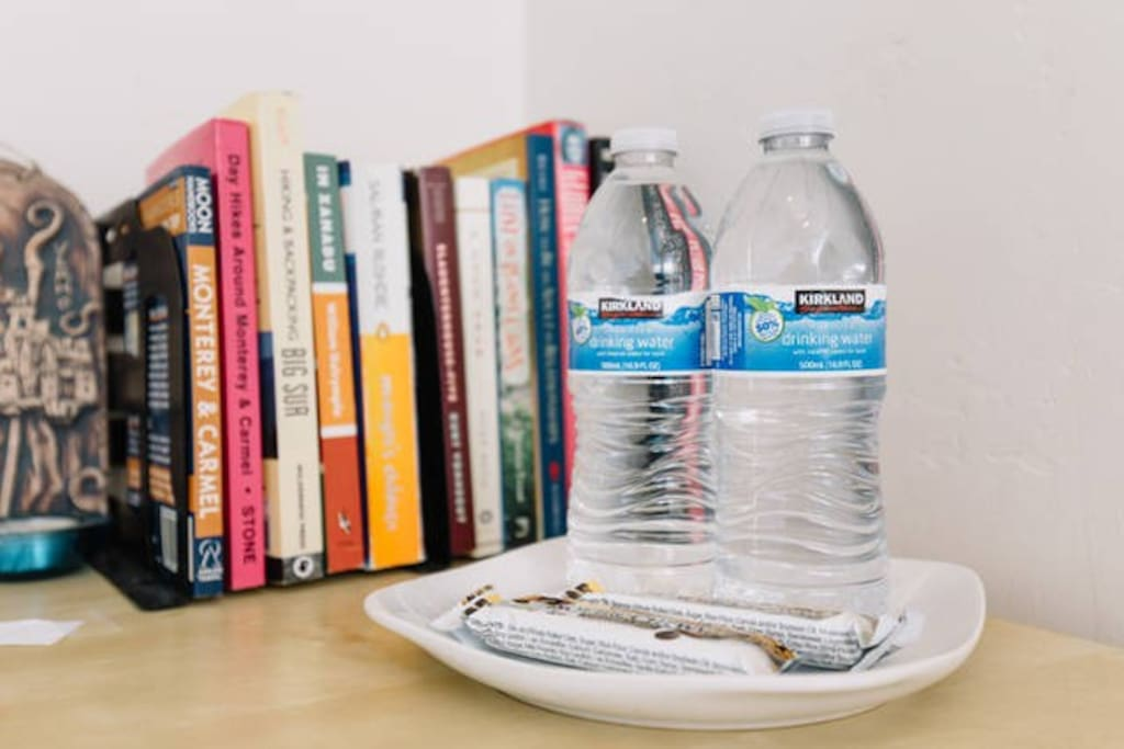 Guest amenities include water and snacks in the room.