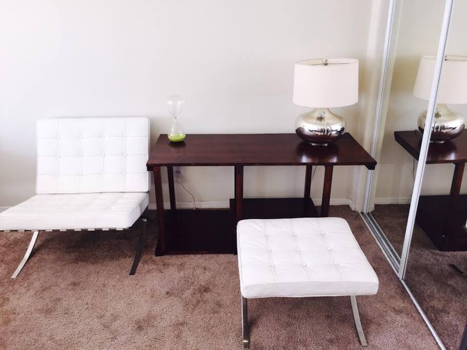 Luxury-chic white leather furniture and stained wood desk
