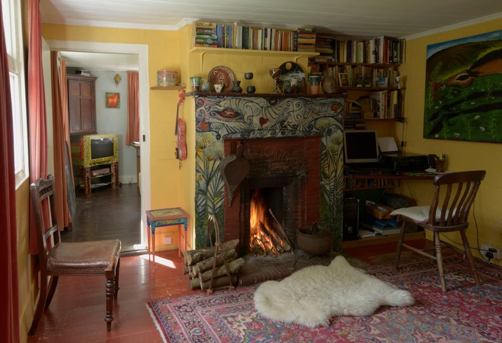 Open fire and painted fireplace