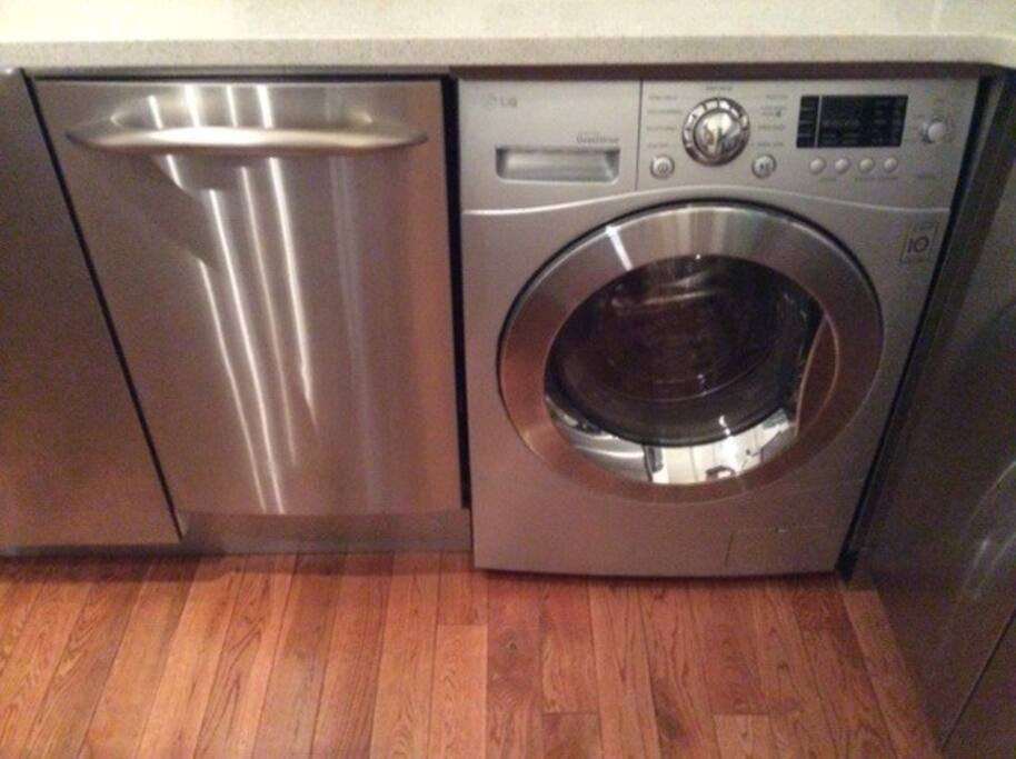LG washer dryer in kitchen & GE dishwasher.