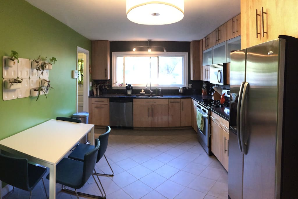 Newly remodeled kitchen with granite counter tops, all stainless steal appliances, gas stove, microwave, filtered water, Kuerig with complimentary coffee and tea, and a dishwasher.