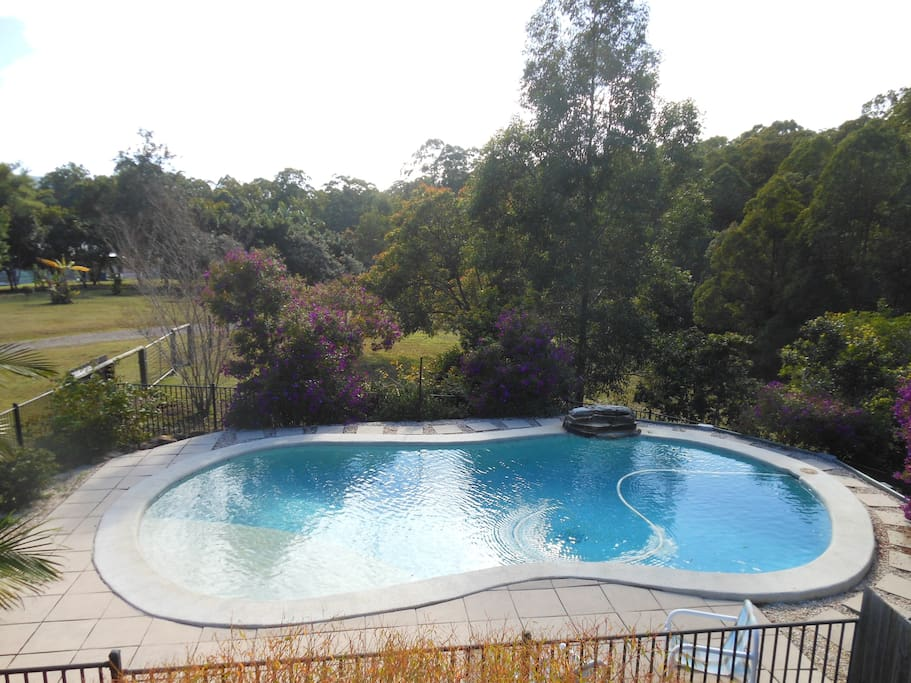 View of the pool from the deck upstairs adjoining the lounge