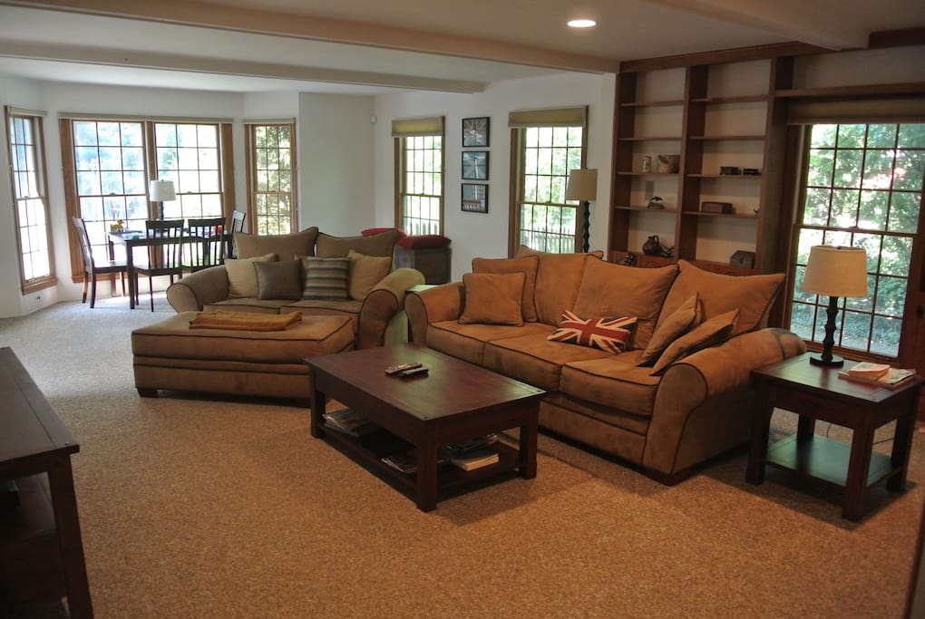 Comfortable Family Room with wall-mounted large screen television, cable and DVD