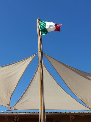The Mexican flag flies proudly over the deck.