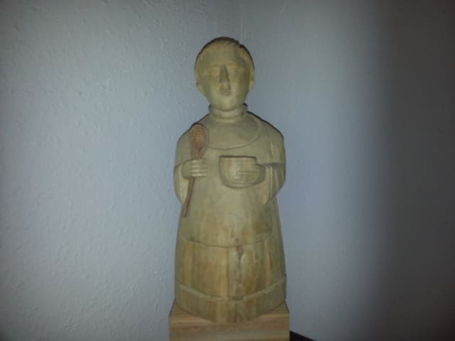 San Pascual Bailon watches over the kitchenette.