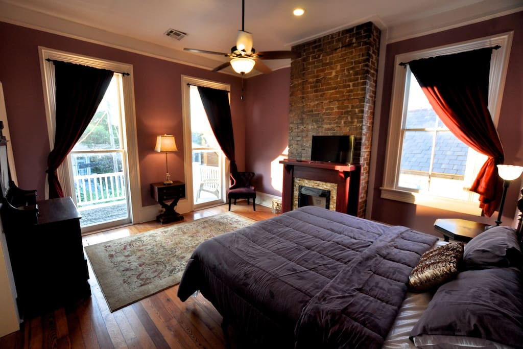 French Quarter Suite- Large room with a touch of romanticism- towering balcony looking over rooftops of the Treme- ensuite shower bath