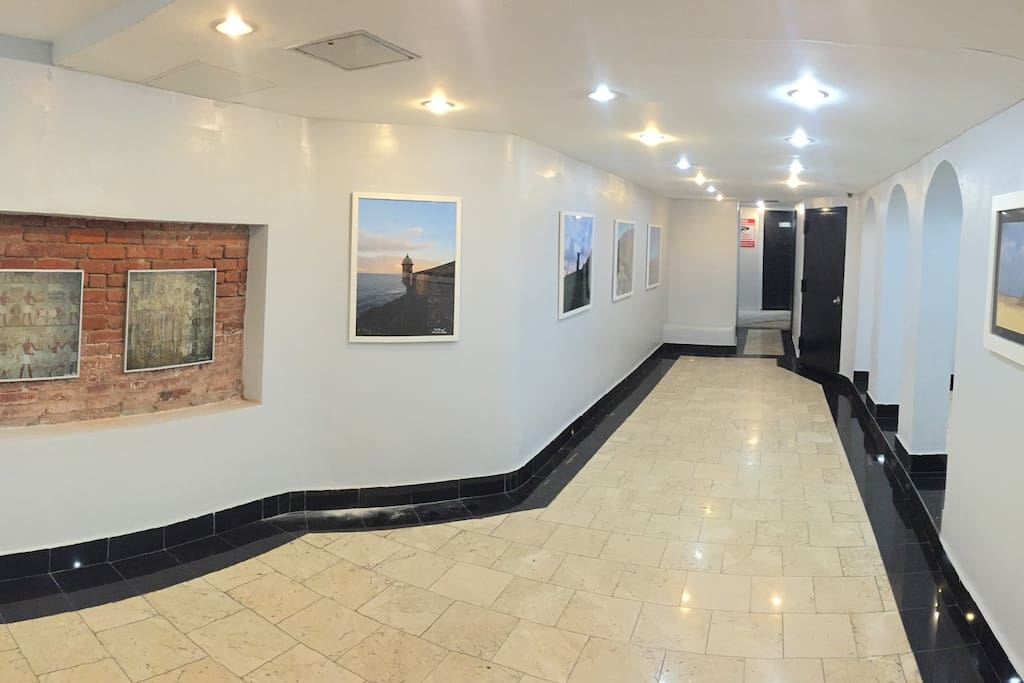Gorgeous lobby with my landscape photography and elevator.