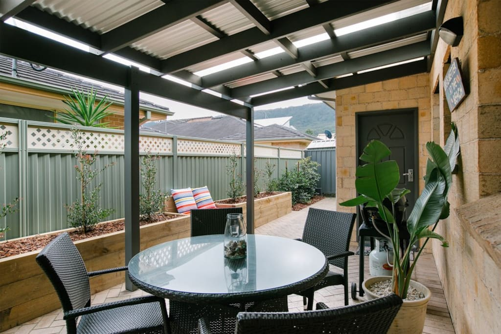 Private courtyard with outdoor dining and BBQ