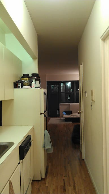 View from the entrance. Kitchen to the left, bathroom to the right.