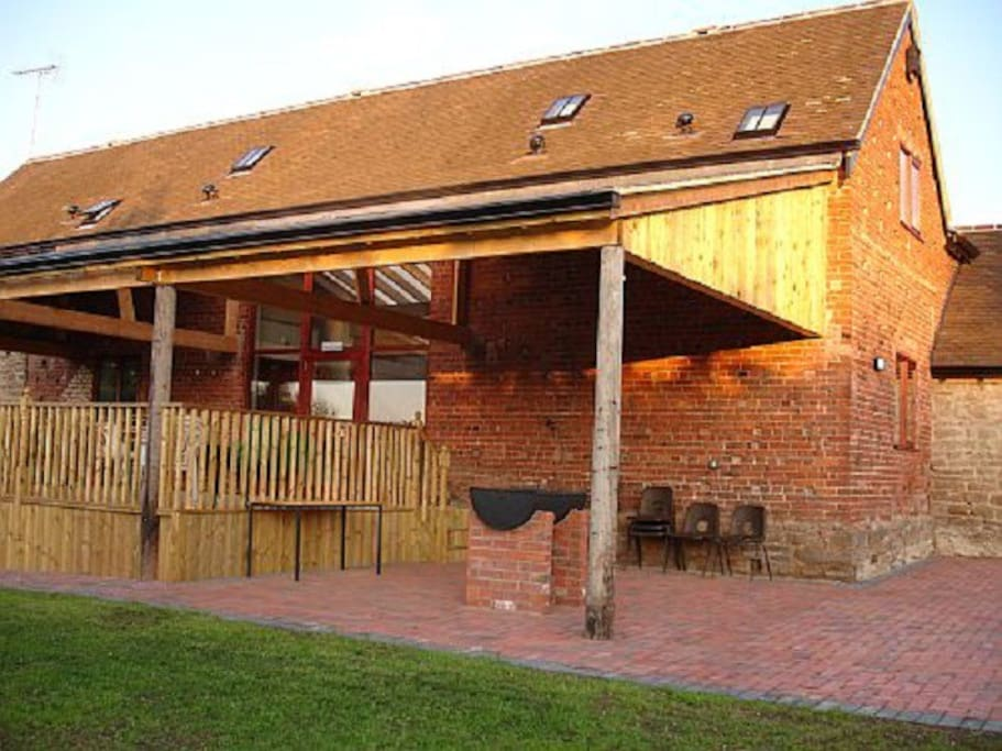 Barbecue and decking areas at the front of the Barn