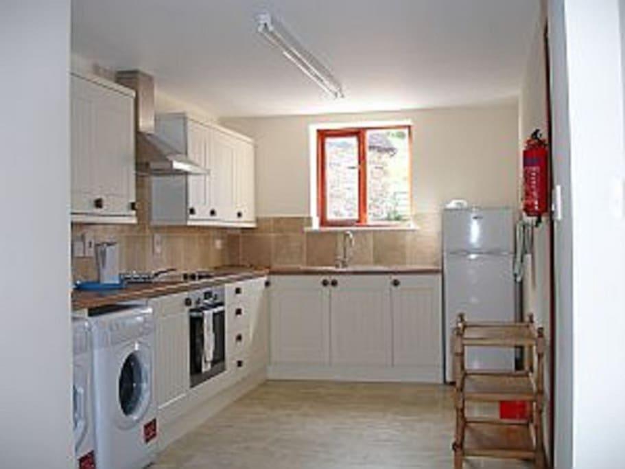 Kitchen with Washing Machine, Dryer, Fridge-Freezer, Microwave, etc.