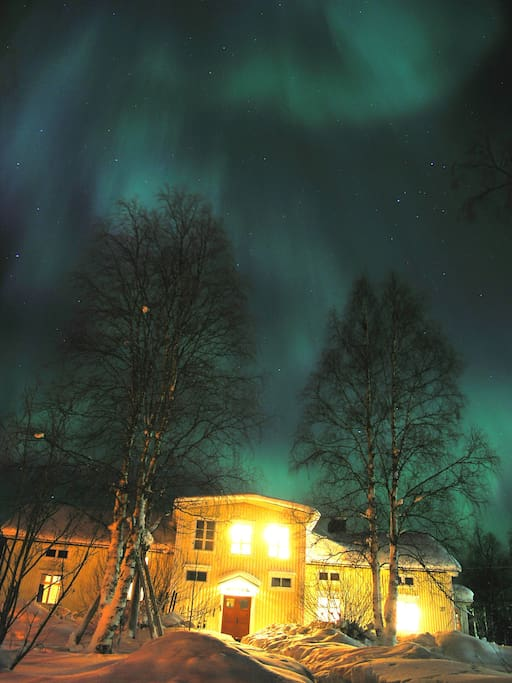 Northern Lights dancing over the house
