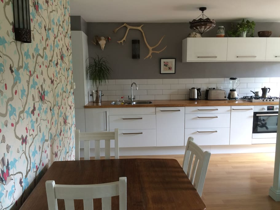 My open plan living/dining kitchen area- designer wallpaper and handpainted furniture.
