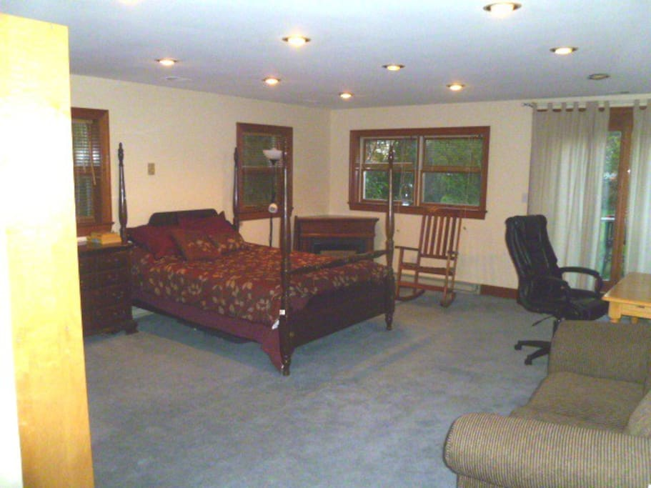 The Larger - it's huge - bedroom, with fireplace, access to the garden, and even more....