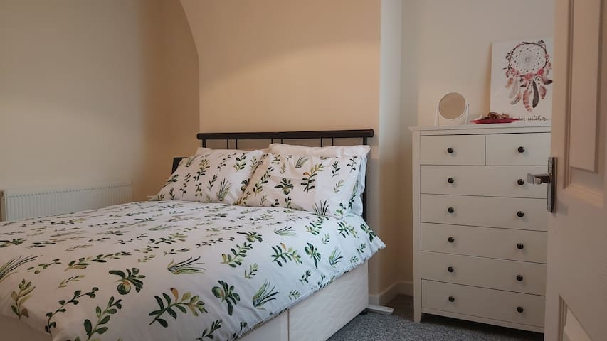The cute and cosy second bedroom upstairs has a double bed, drawers and hanging space for your clothes.  You won't want to leave, this room is so inviting!