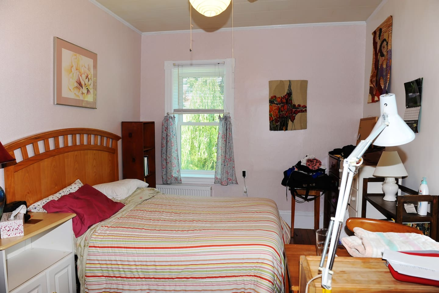 Your bedroom -- original art and view of bike-path.
