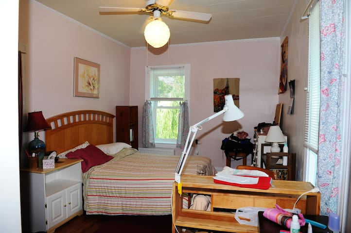 Bedroom includes a small desk.