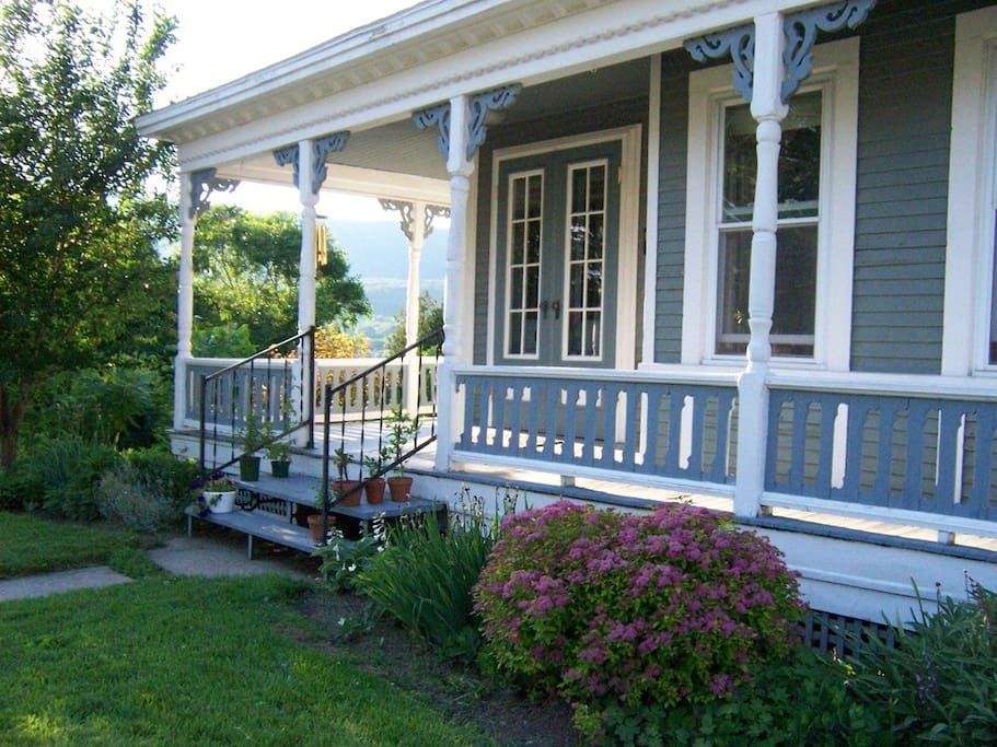 Lovely wraparound porch with view of Mount Greylock on one side