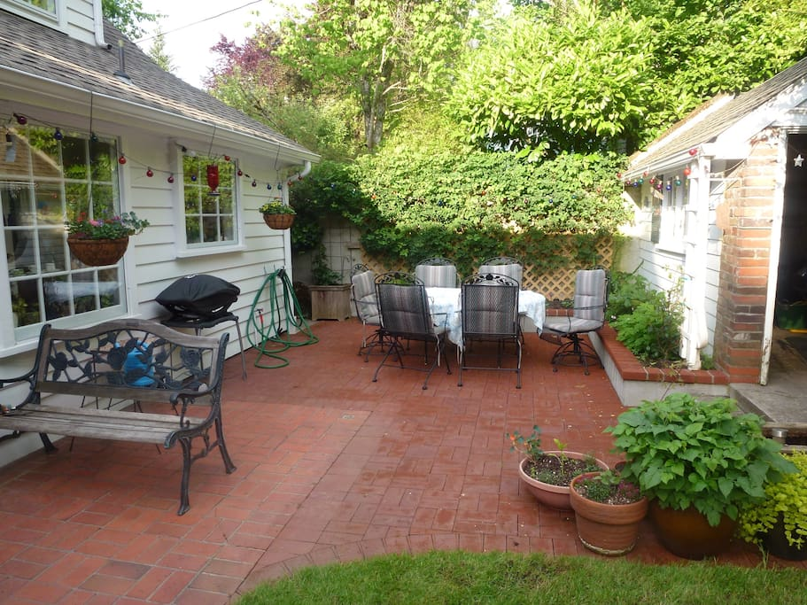 Patio in rear, which includes, Weber gas grill, table and chairs, beautiful gardens, and sitting area(not pictured).