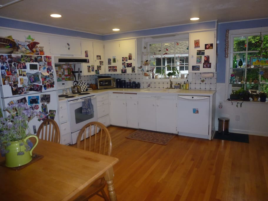 Kitchen, includes full size refrigerator, stove/oven, dishwasher and table that sits 5...