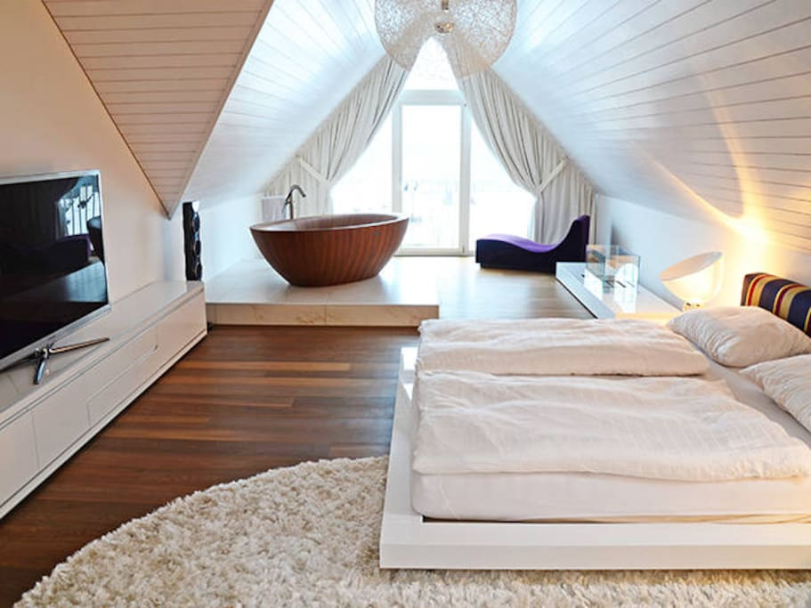 Master bed room (50m2) with a designer bath tube