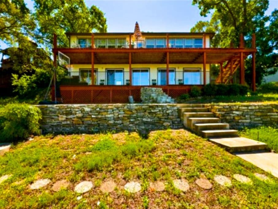 Back of the house with two large decks overlooking Lake Travis.