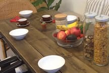 We provide you with Muesli / Cereal, Black Forest pasture milk and fresh fruit.