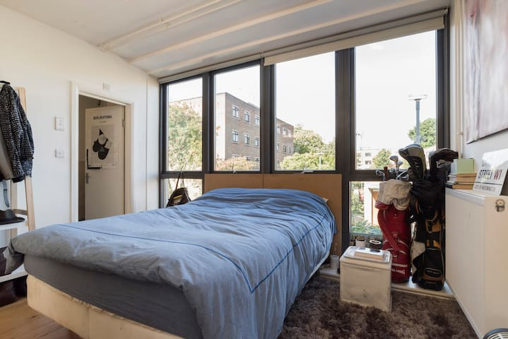 King size bed with natural light all day