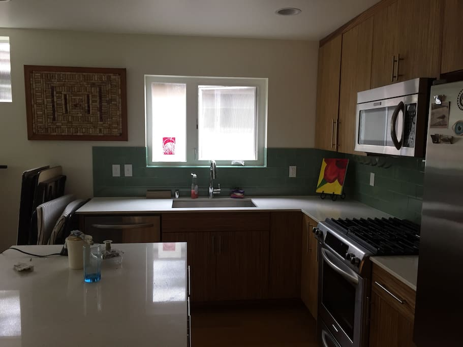 Full kitchen has gas range, microwave, dishwasher, fridge & tons of counter space and a counter eating space on the large island