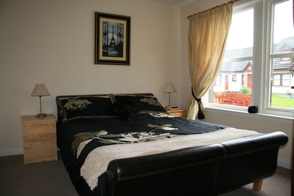 Master bedroom. Comfortable  Kingsize Leather bed with quality bedlinen.