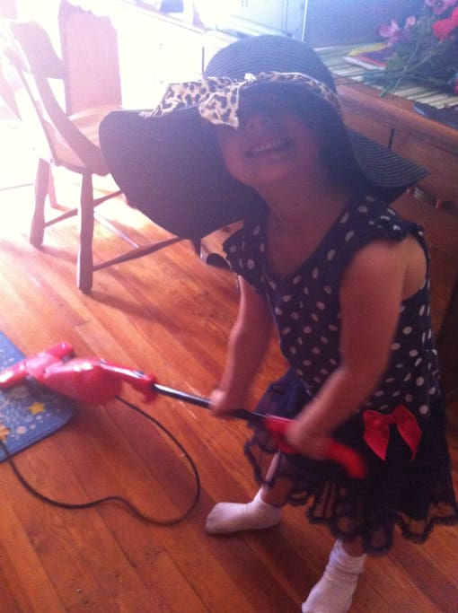 Victoria cleans the house