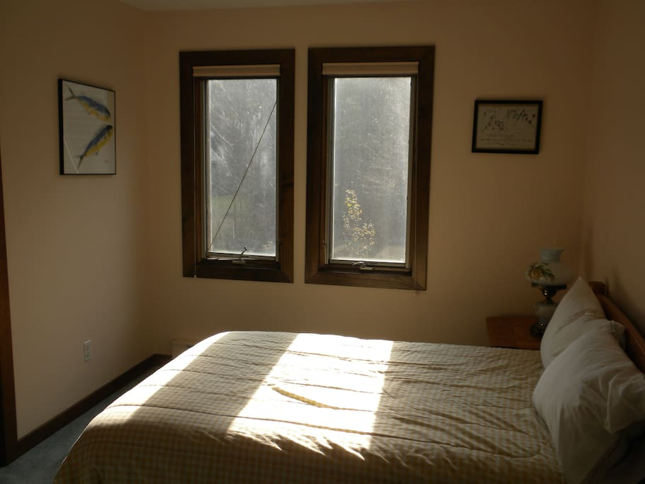 Full size bed in large upstairs bedroom