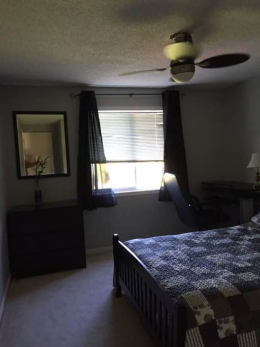 Bright, 10x12 room with desk, chair, dresser and double comfy bed
