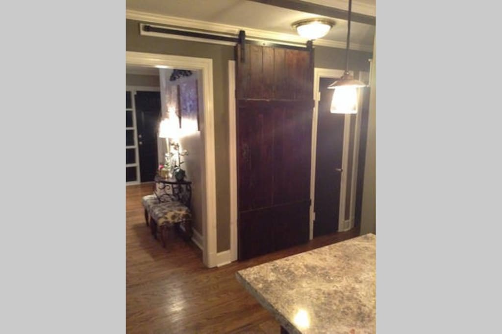 Leading from the kitchen to the basement is a sliding rustic barn door we made and hung ourselves (wasn't easy!). Guests usually point out this unique feature as one of their favorite aspects of the house.