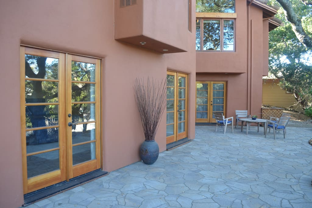 Three sets of french doors and outdoor seating