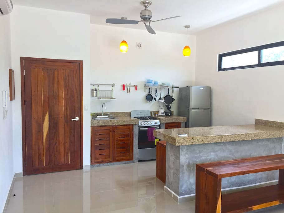 Spacious and comfortable dining area attached to a fully equipped kitchen
