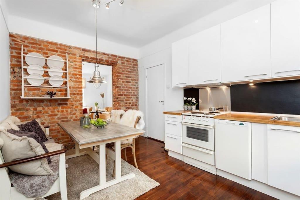 Charming kitchen with brick walls.