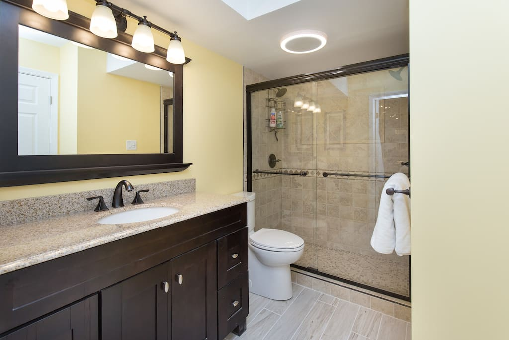 Custom double shower, with  bluetooth  audio speakers so you can connect with your Iphone and enjoy your favorite tunes!