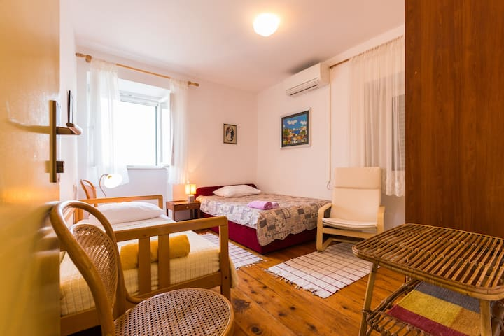 room A, queen and single bed, seaview