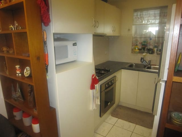 Full functioning kitchen including gas stove, elec oven, fridge, kettle & toaster