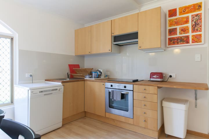 Kitchen with dishwasher and fan forced oven