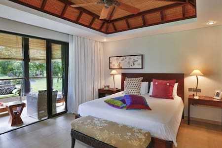 The  main bedroom with  its  en- suite bathroom
