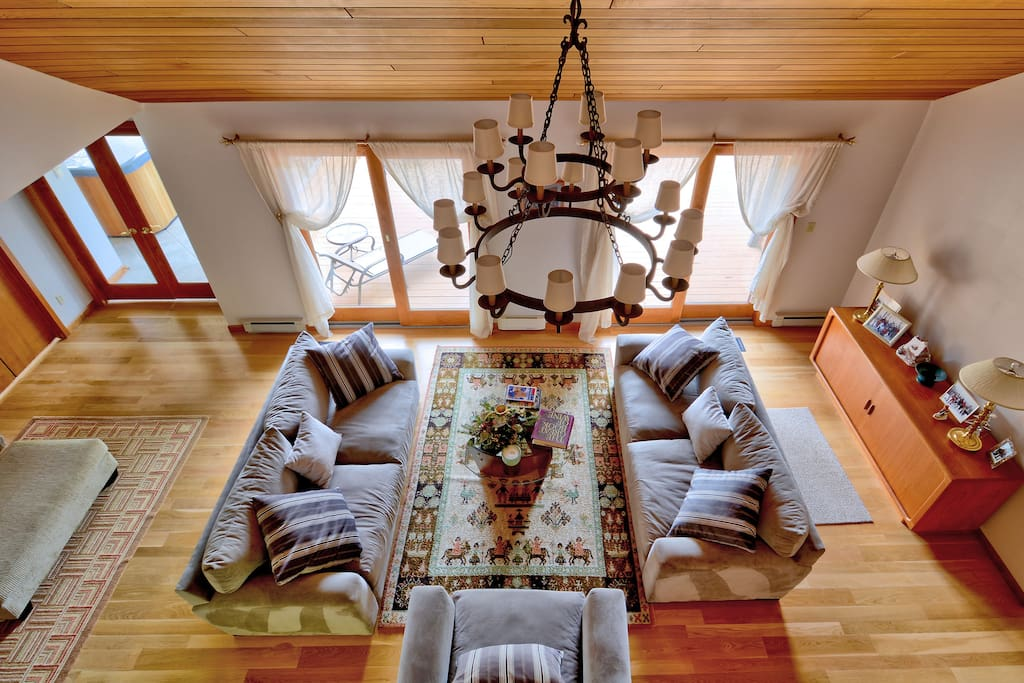 The Great Room, from The Loft-  Features 2 sided gas fireplace, access to The Deck and pocket wet bar