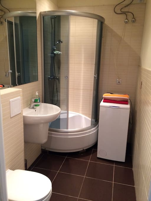 Fresh and recently renovated bathroom. Washing mashine.