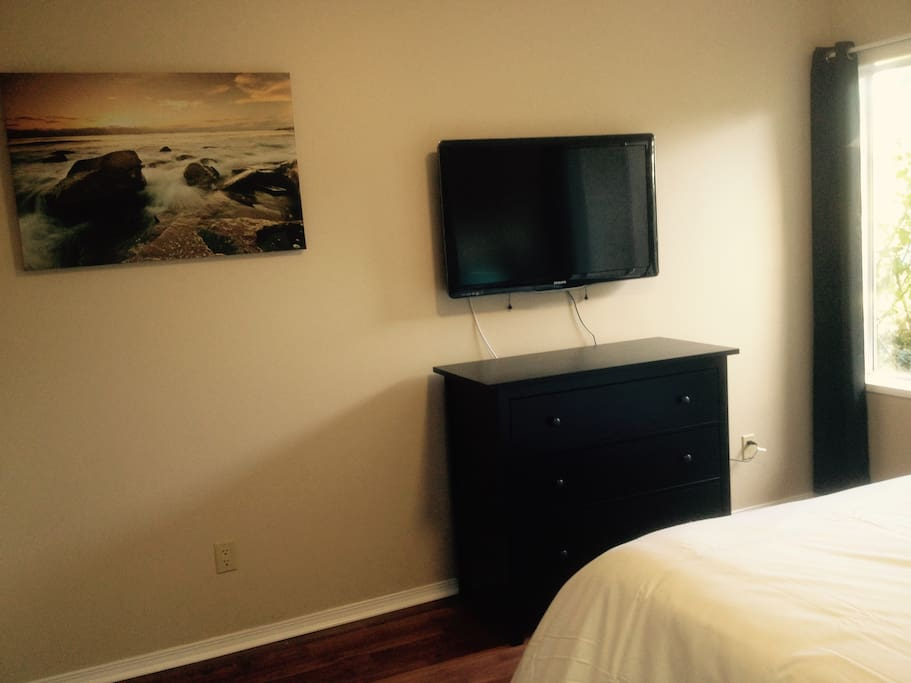Wall-mounted cable tv in the bedroom.