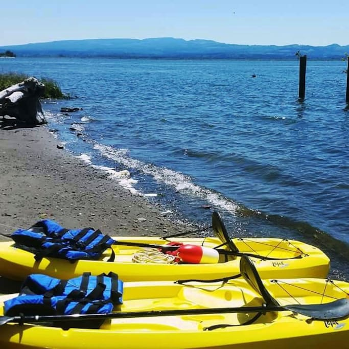 A view from the beach on the Columbia River ... launching kayaks from the boat ramp.