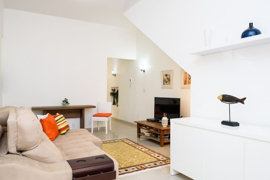 A modern Living Room ; Dinner Table ; Cable TV ; Sofa ; Wifi ; Air Conditioner